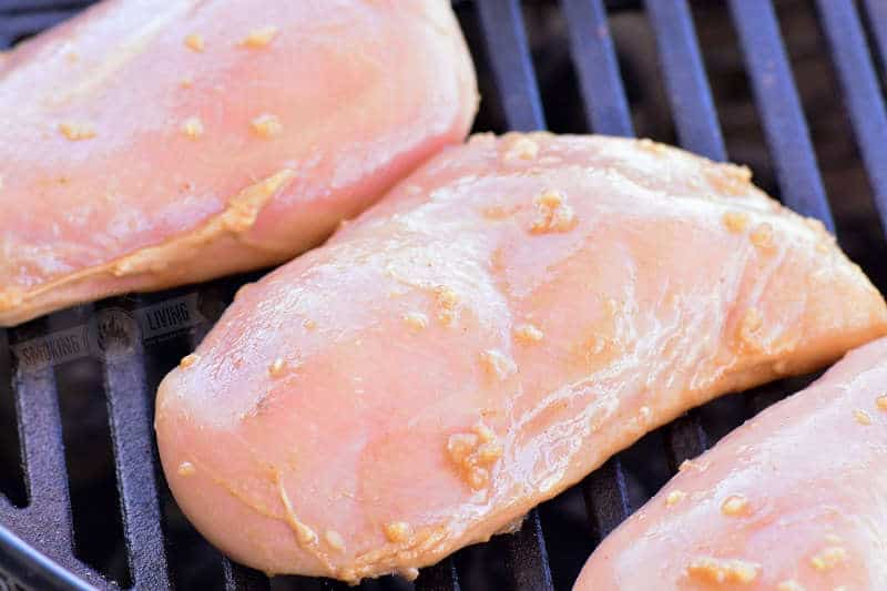 raw chicken on the grill