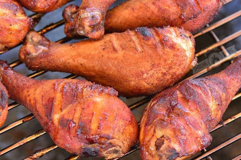 cooked chicken drumsticks on the smoker grate