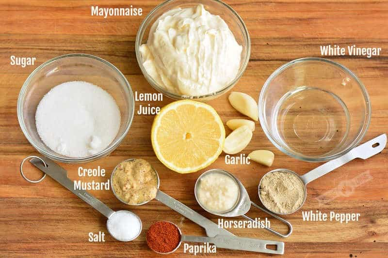 all ingredients that are in the sauce on the cutting board