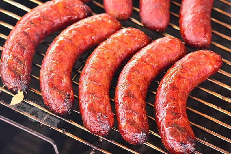 cooked smoked sausage on the smoker grate