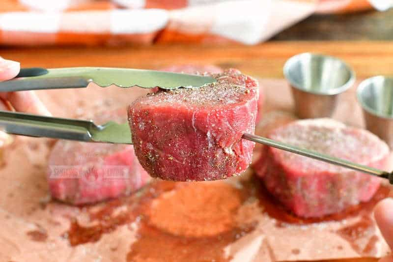 inserting thermometer probe into a filet