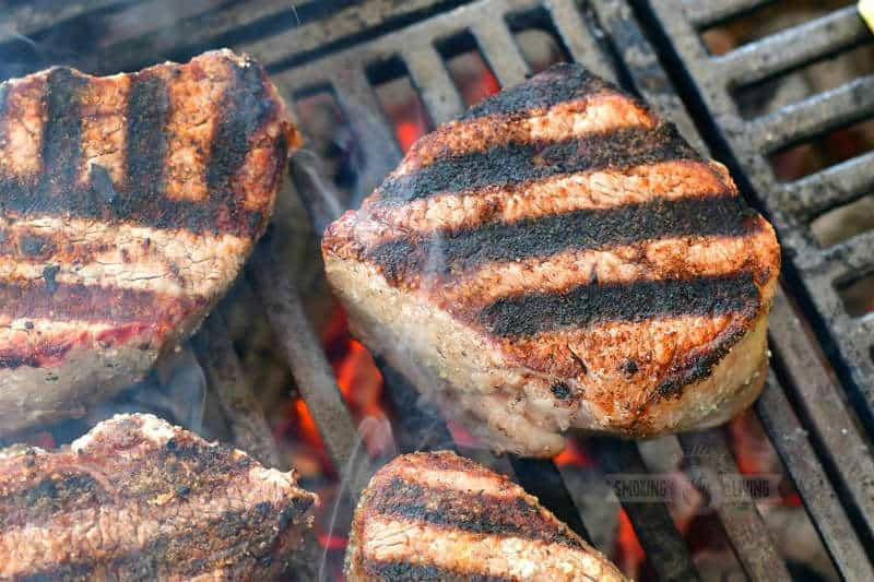 closeup of one fillet on the grill with grill marks