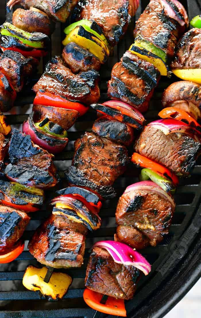 closeup of cooked steak and vegetables on the skewers