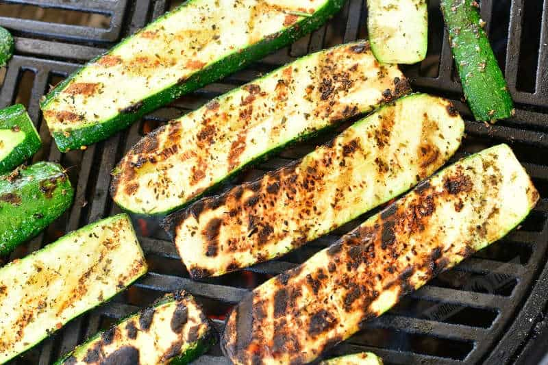 long grilled zucchini slices on the grill