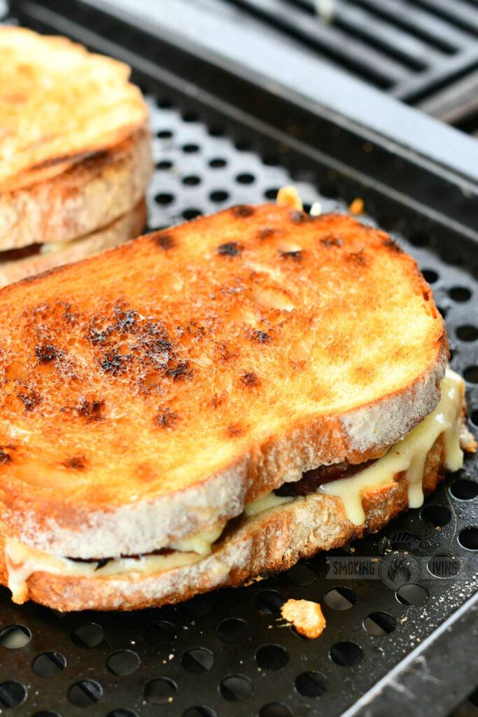 closeup of a grilled cheese sandwich cooking on the grill in a basket