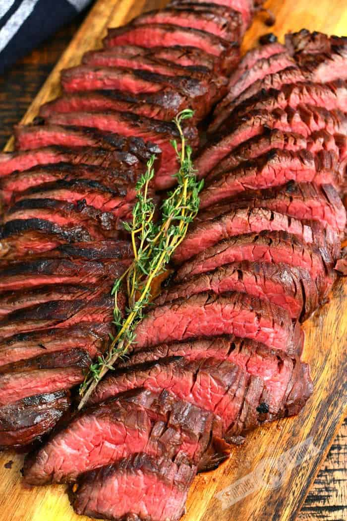 hanger steaks sliced thinly with a sprig of thyme on top