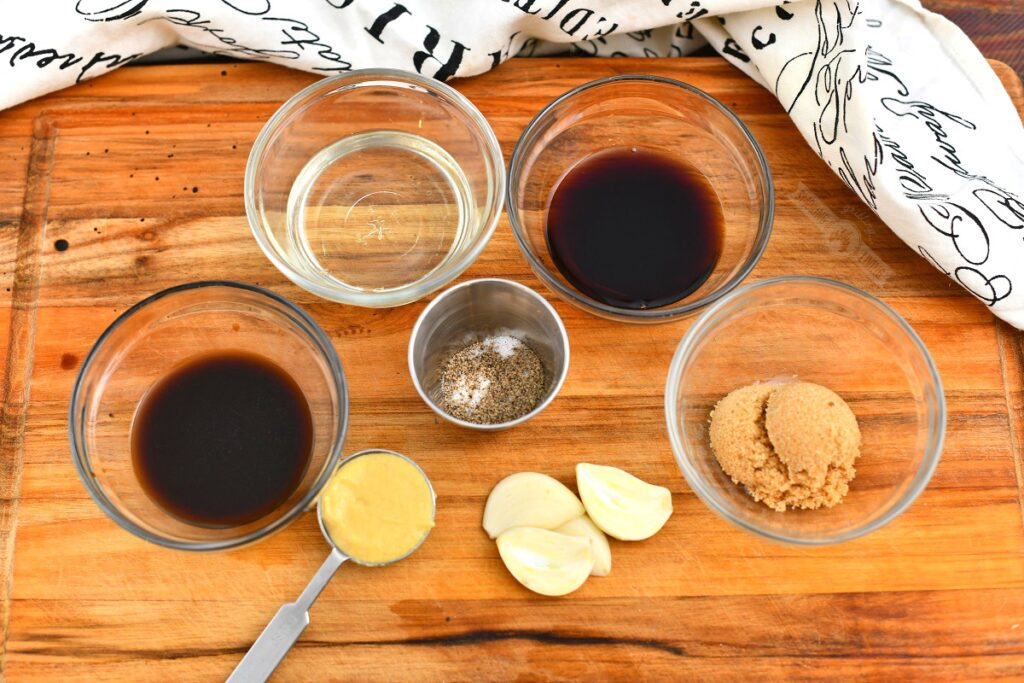 ingredients for the chicken marinade in glass bowl and spoons on the cutting board