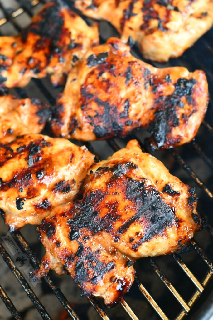 top view of grilled chicken thighs on the grill