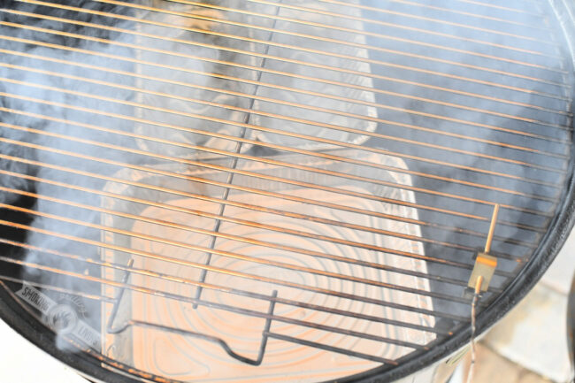 three aluminum pans on the lower smoker grate