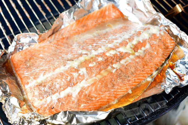 cooked salmon on foil on a smoker