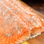 smoked salmon on a wood cutting board
