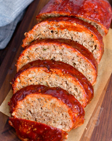 top view of sliced meatloaf on a wooden cutting board