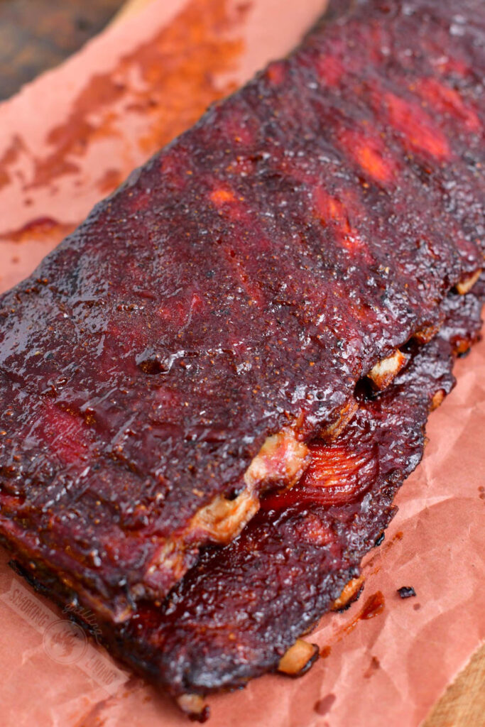 two stacked St. Louis racks of ribs on butcher paper