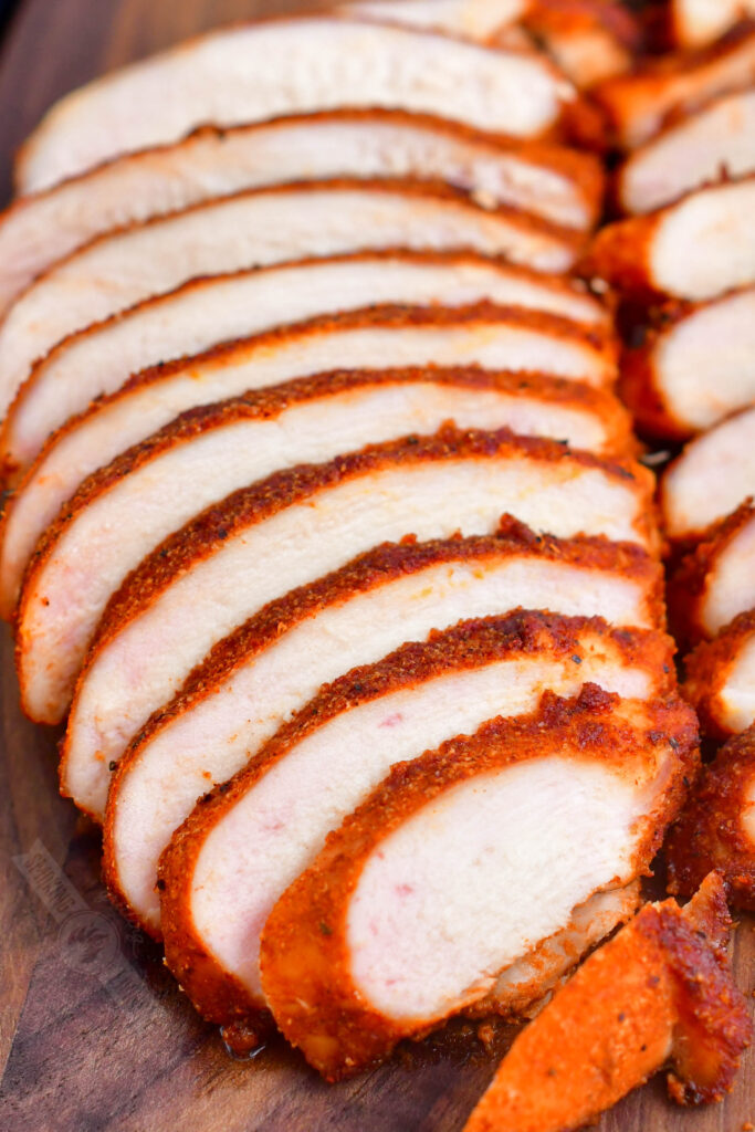 side view of sliced smoked chicken breasts