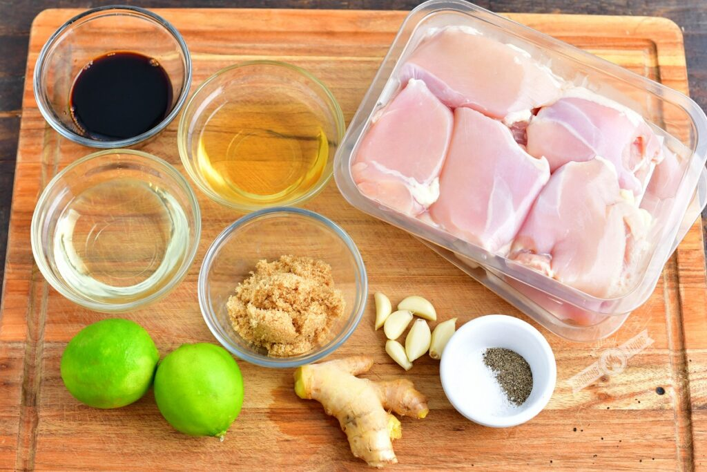 ingredients for chicken thighs and marinade on a cutting board