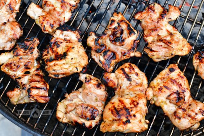 cooked chicken thighs on the grill
