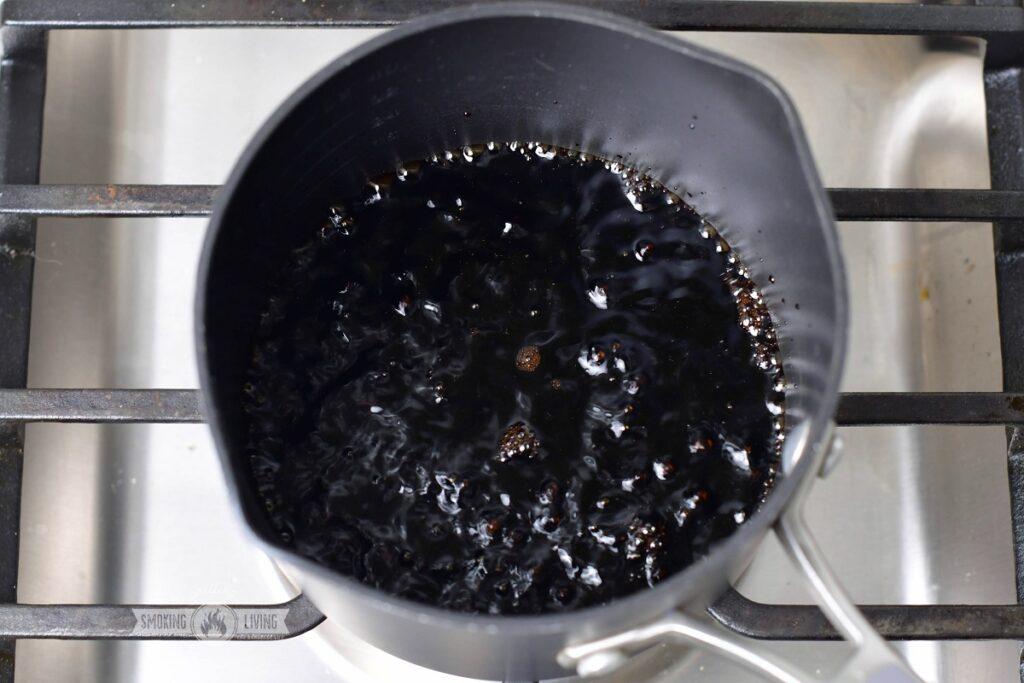 simmering balsamic vinegar in a sauce pot