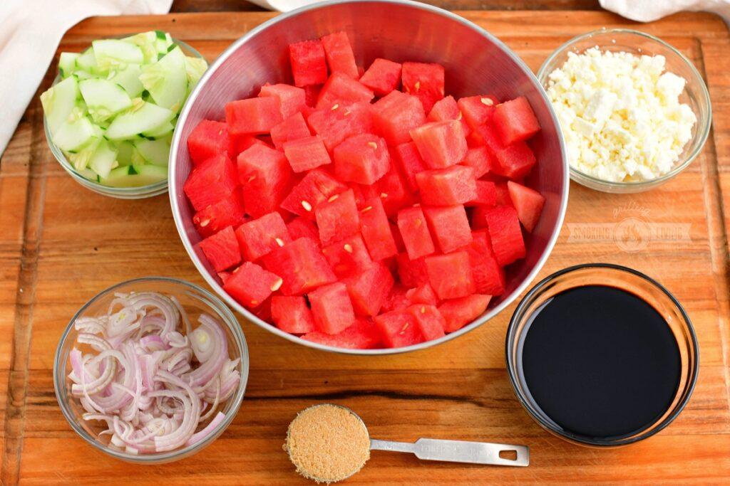 ingredients for watermelon feta salad on a cutting board