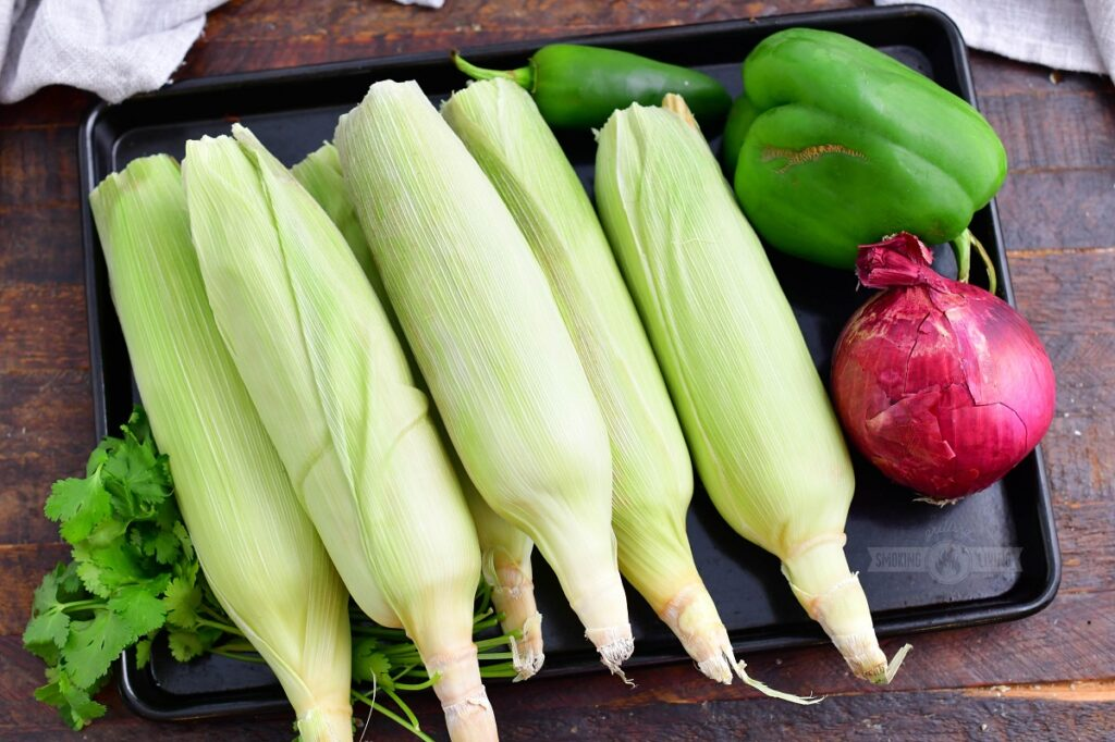 ingredients for grilled corn salad on a metal tray