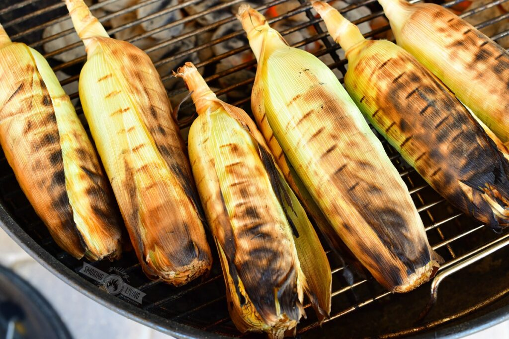 grilled corn in husks on a grill