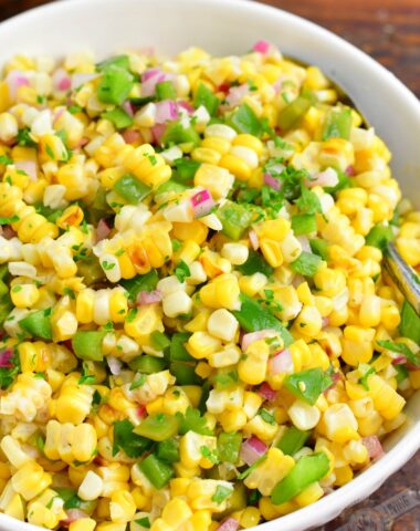 finished grilled corn salad in a white bowl