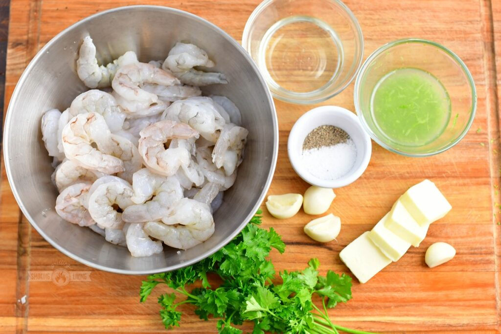 ingredients for grilled shrimp skewers on the cutting board