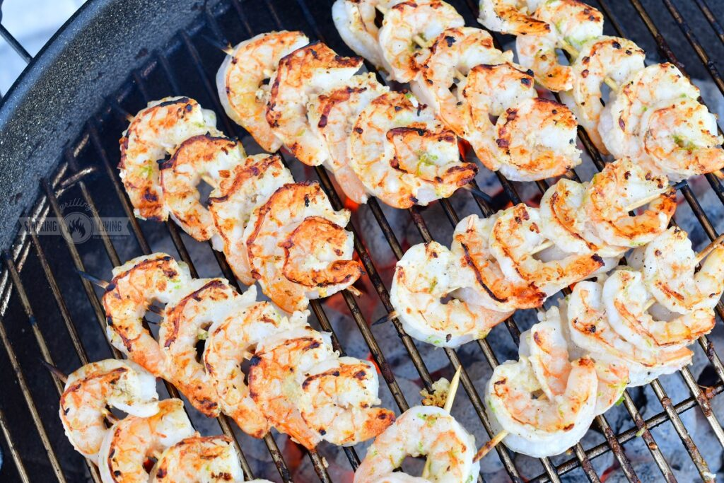 shrimp skewers cooking on the grill