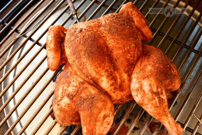 cooked chicken on the smoker with internal thermometer