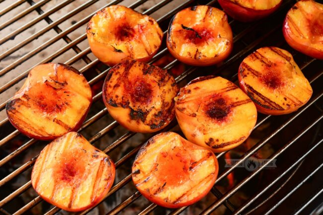 grilled peaches on the grill grate