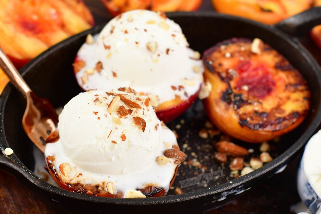 grilled peached is cast iron dish with ice cream