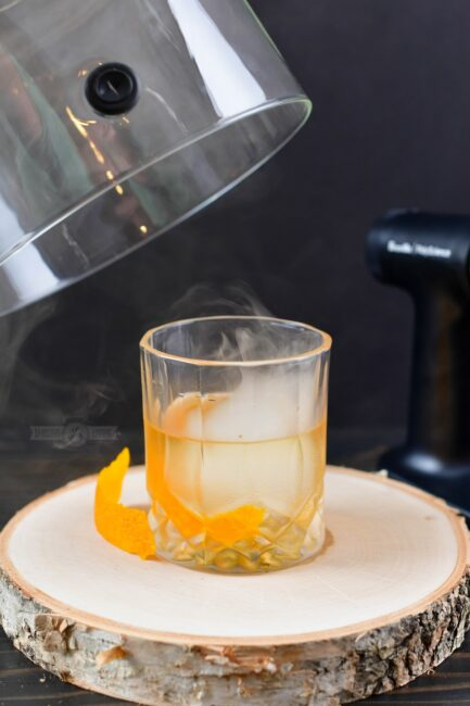 smoked cocktail in a glass with orange peel